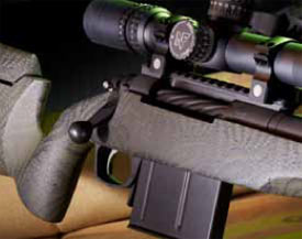 Starting at the thin forend tip, the stock is significantly slimmed down to where only about 0.75 inches of material span the distance from the bottom of the barrel channel to the bottom of the forend.