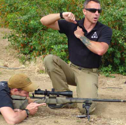 Magul Dynamics instructor Caylen Wojcik instructs student shooters in the importance of proper rifle positioning for obtaining a consistent firing platform.